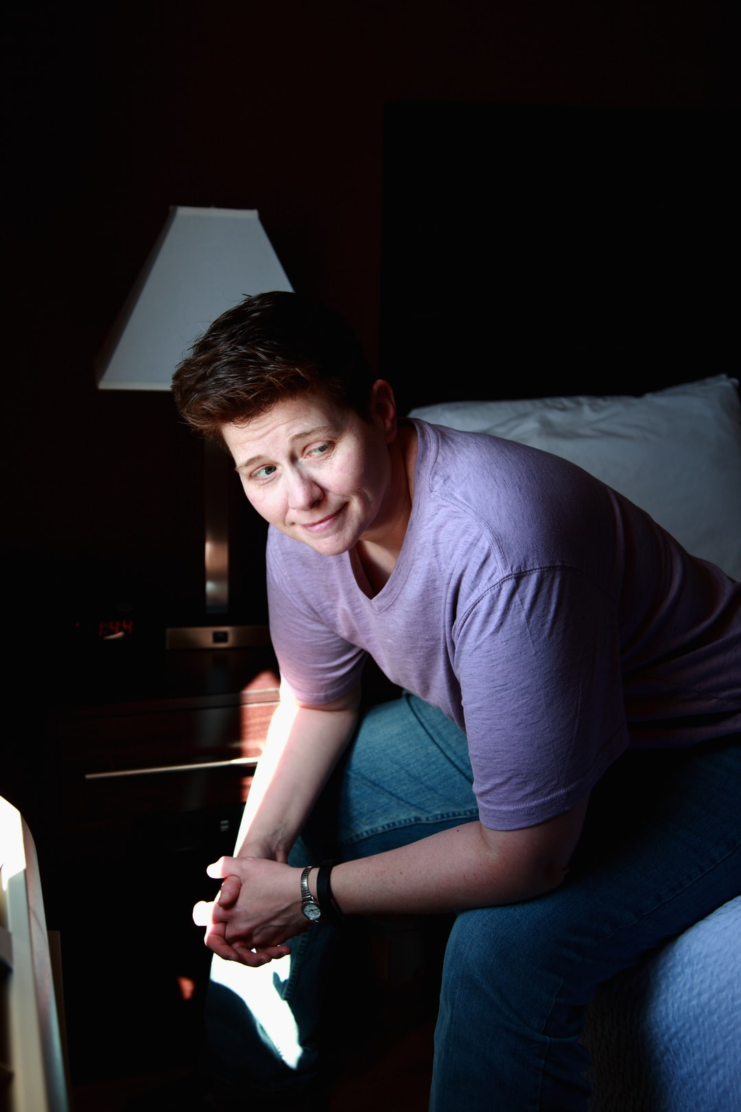 Shane smiling at the hotel in window light.