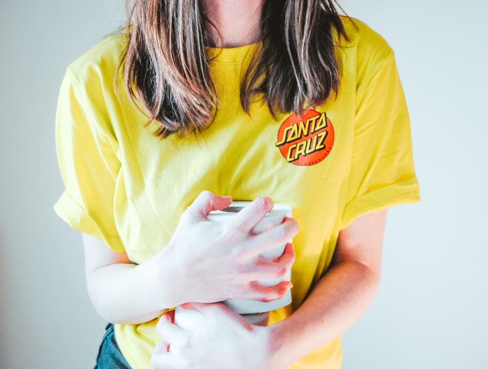 woman in yellow crew neck t-shirt