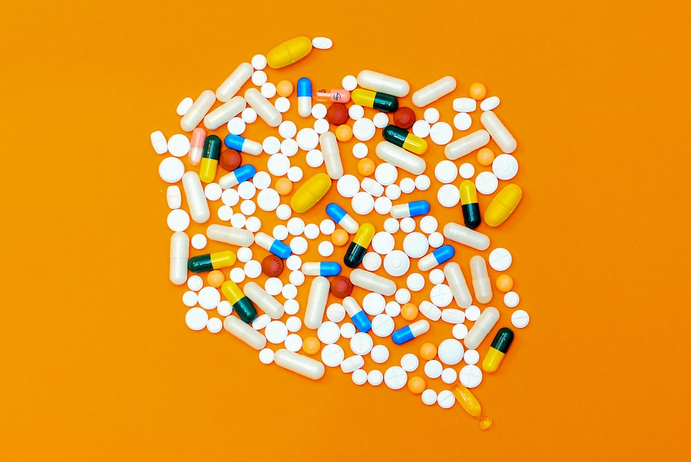 white and orange medication pill
