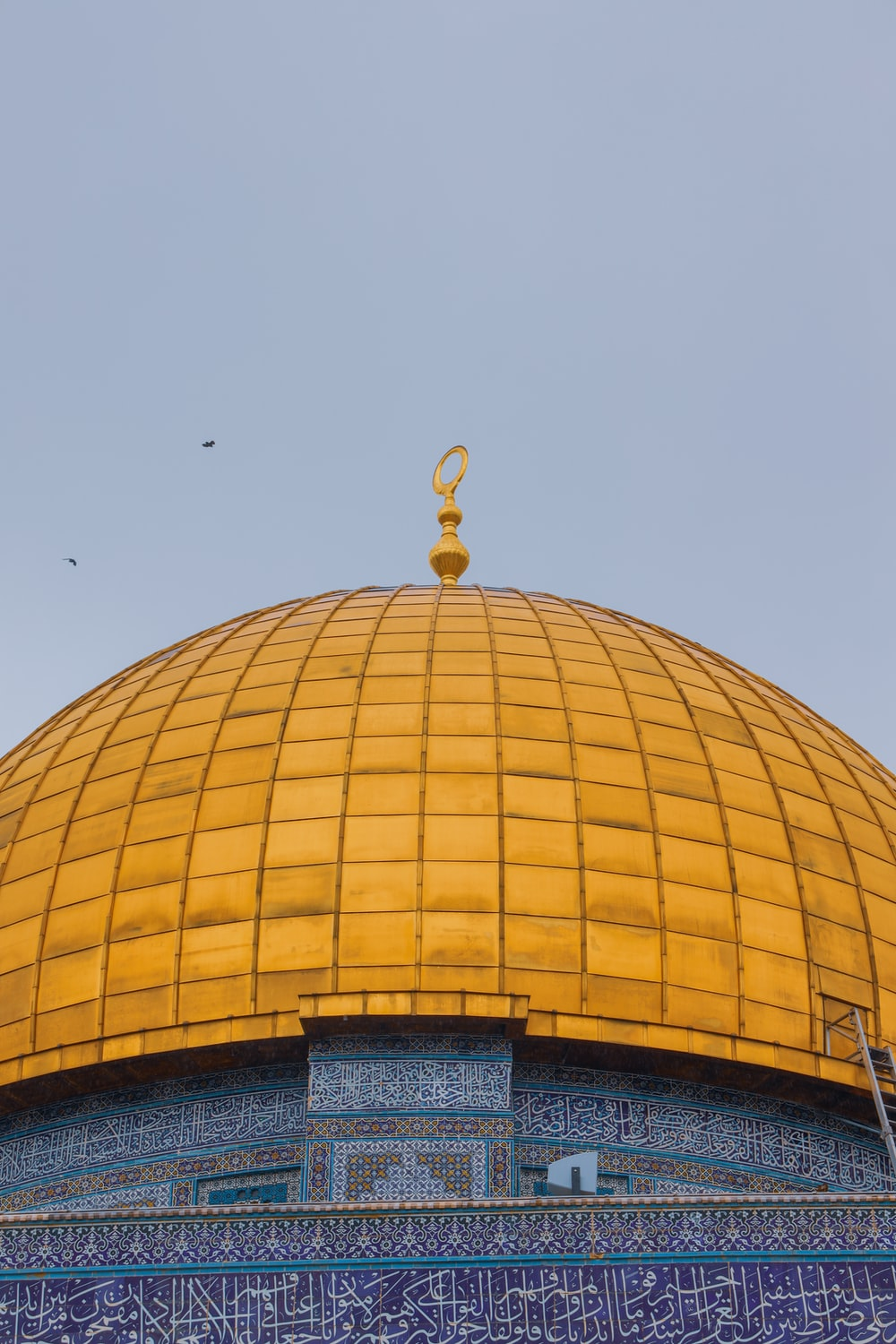 yellow dome building under blue sky during daytime