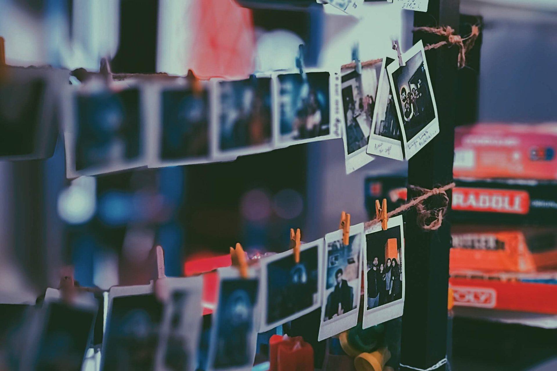 assorted photos on white shelf