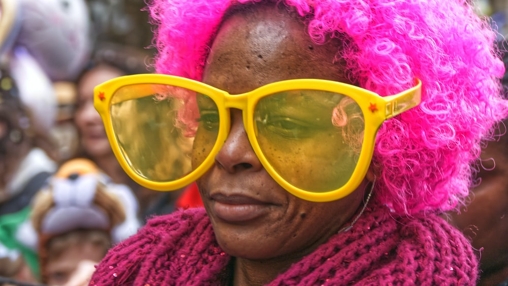 woman in yellow framed sunglasses
