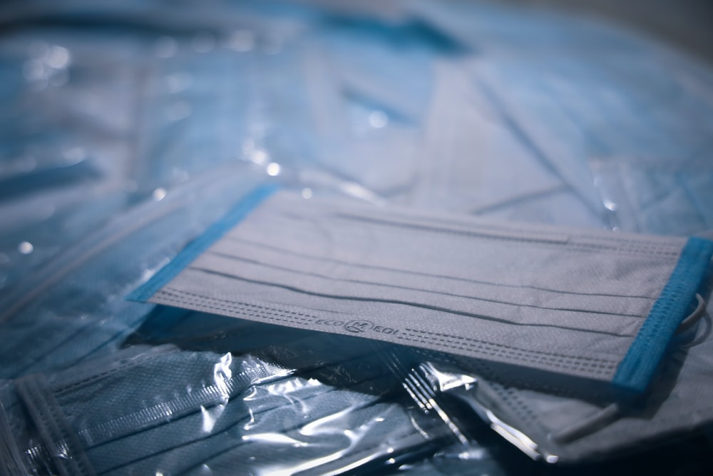 blue textile on clear plastic pack
