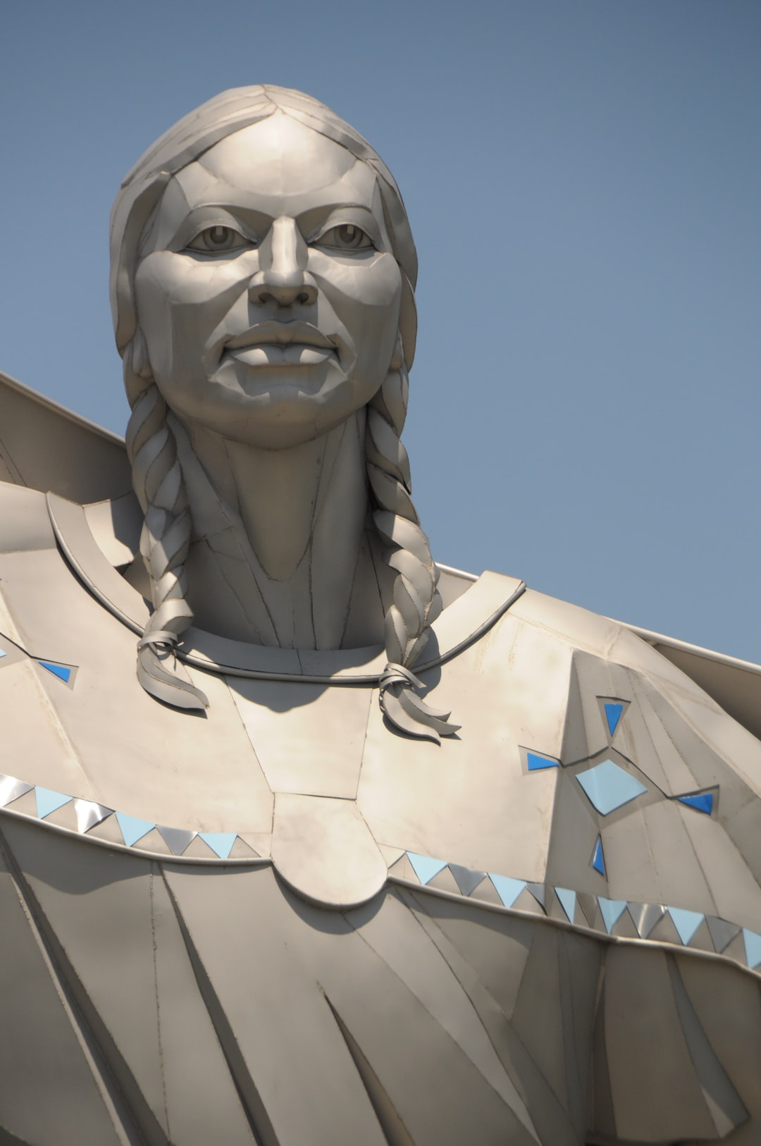 DIGNITY statue closeup Native American Indian Sioux woman star quilt sculpture Dale Lamphere sunset South Dakota Missouri River overlook