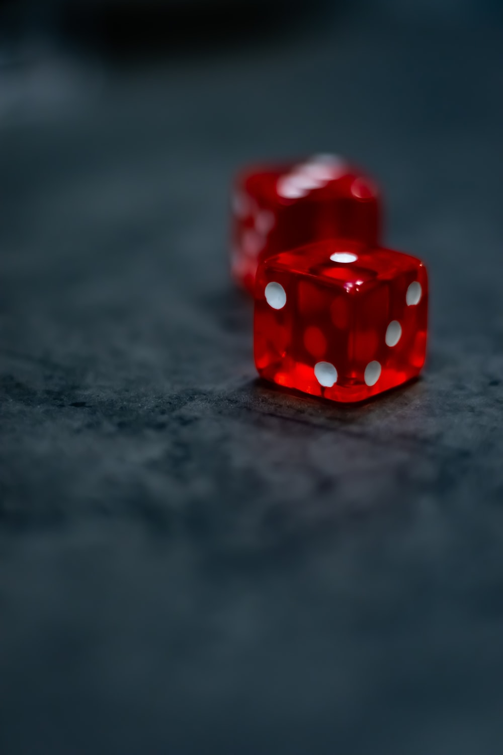 red and white dice on black surface
