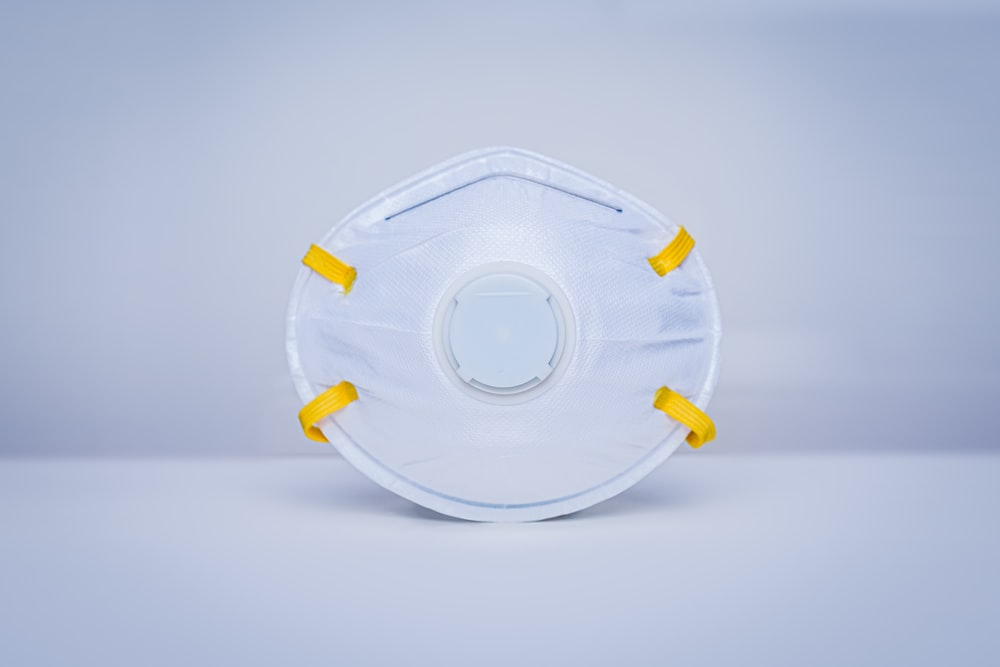 white round plastic container on white surface