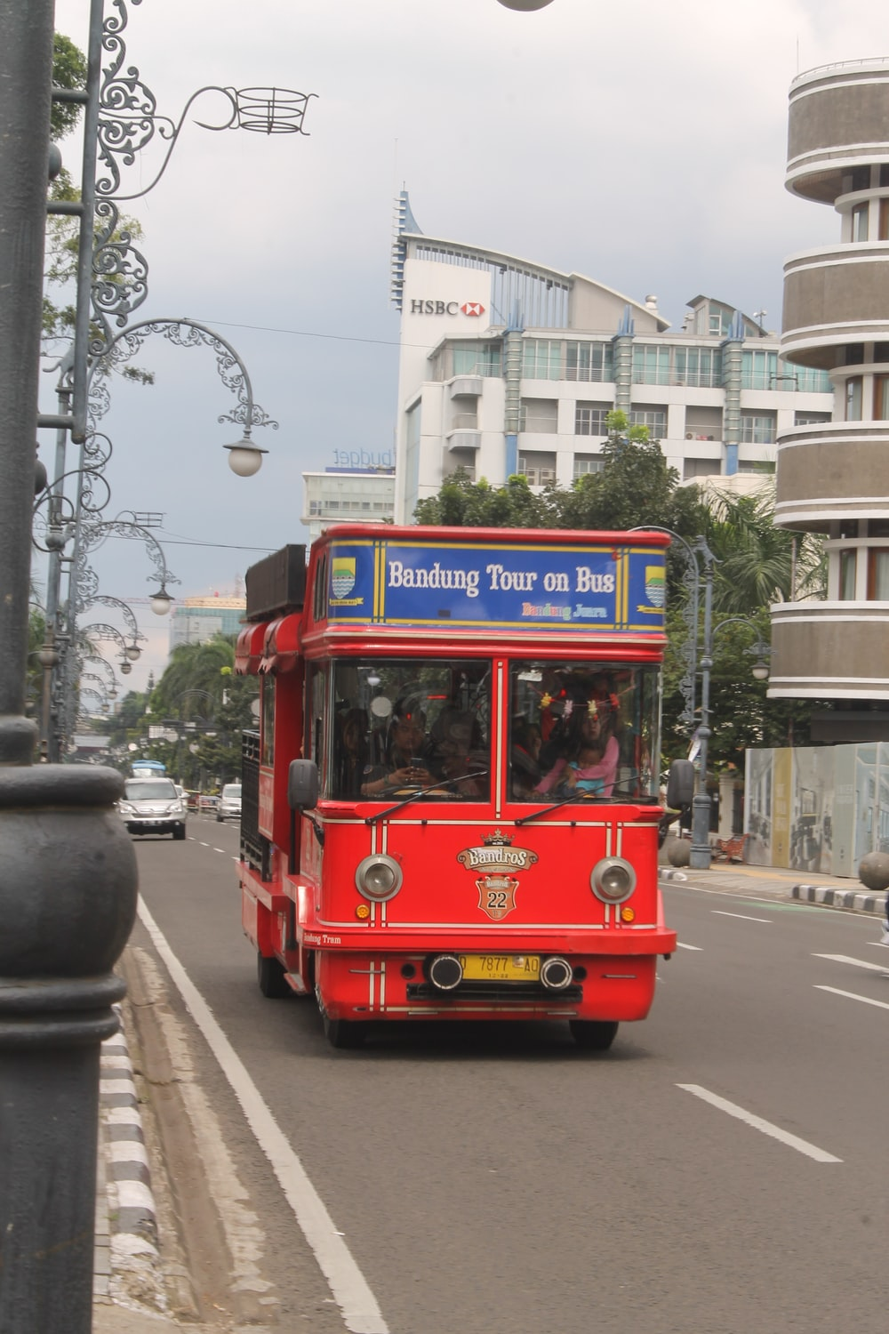 red and blue bus on road during daytime