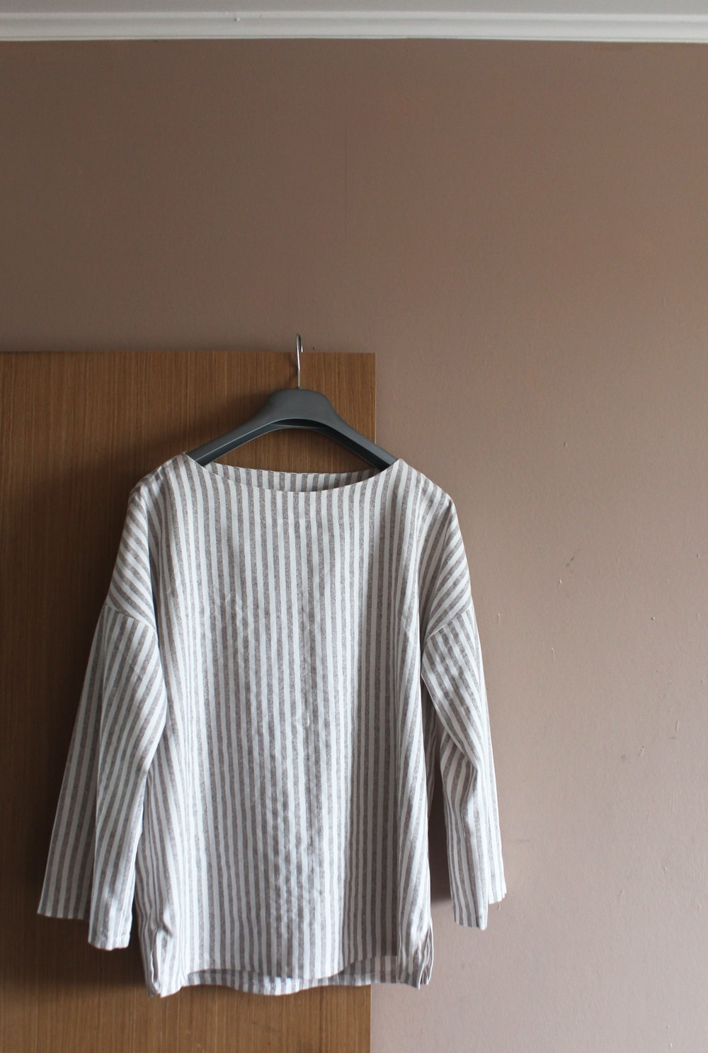 white and black striped long sleeve shirt