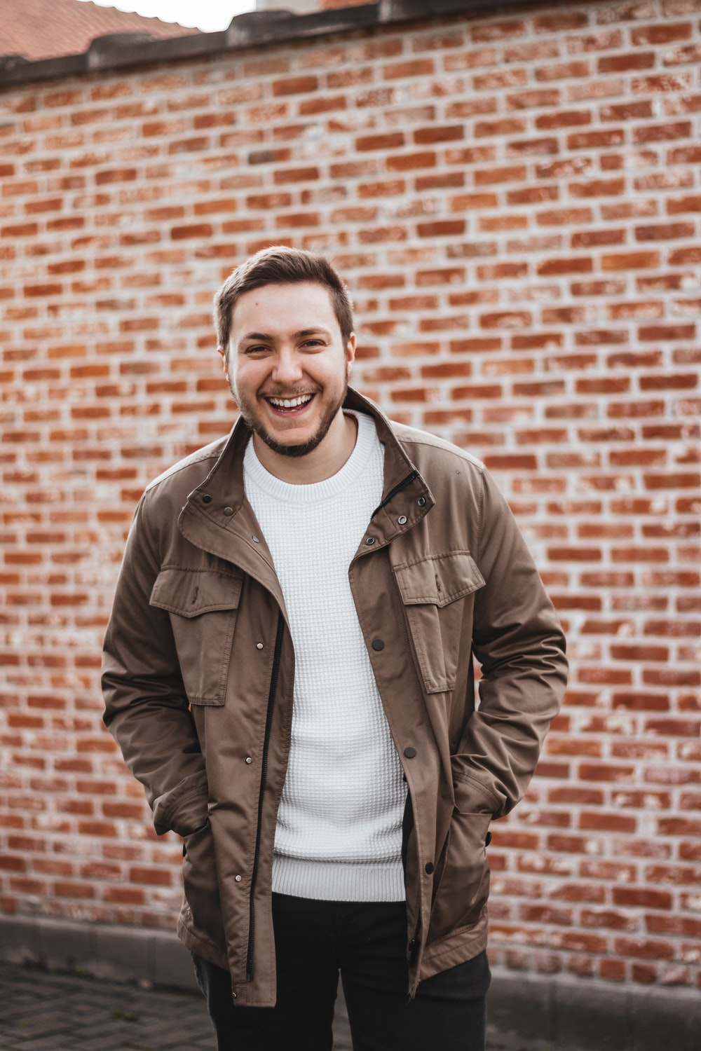 man in brown leather jacket smiling