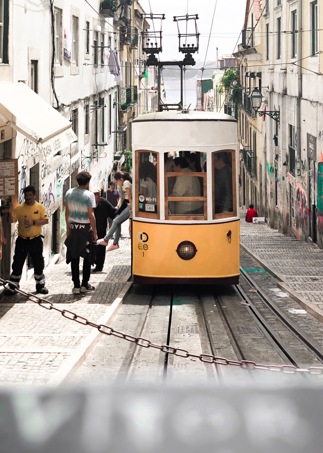 Iconic yellow tram No.28! Somewhere in the centre of Lisbon. 🇵🇹🚃