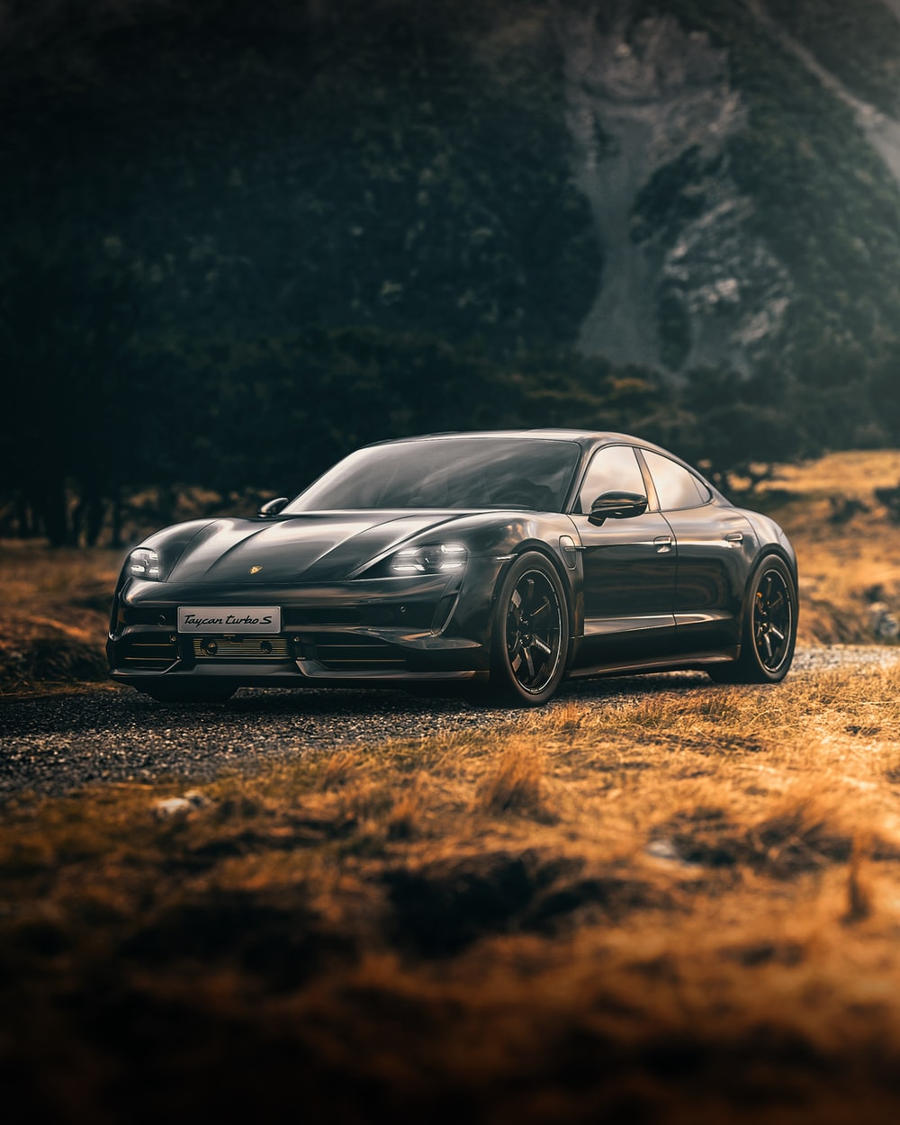 black mercedes benz coupe on brown soil