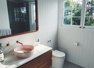 white ceramic sink with stainless steel faucet