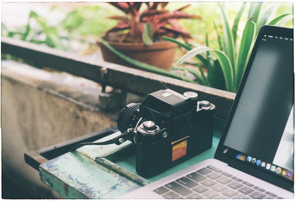 black camera on black laptop computer