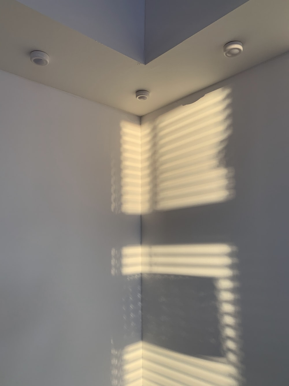 white window curtain on white wall