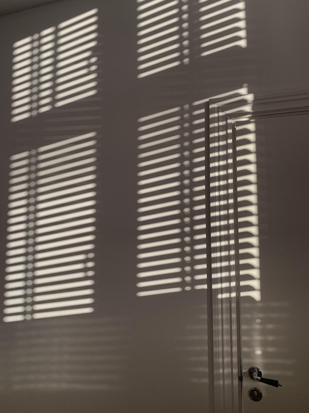brown window blinds on window