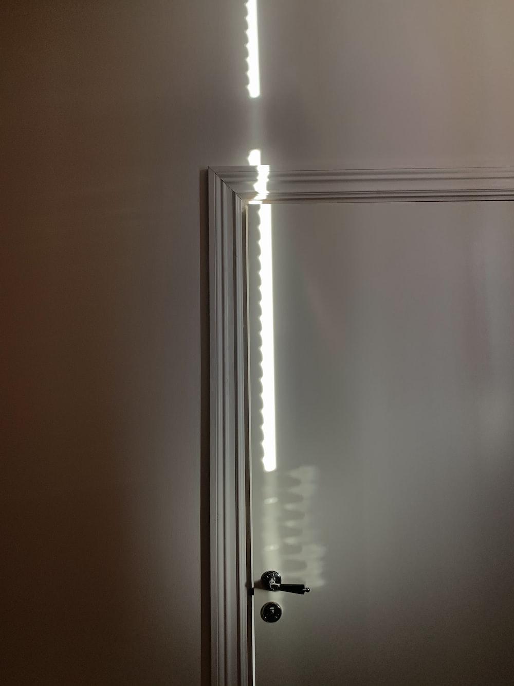 white window curtain on white window