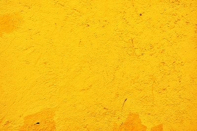 yellow concrete wall during daytime yellow zoom background