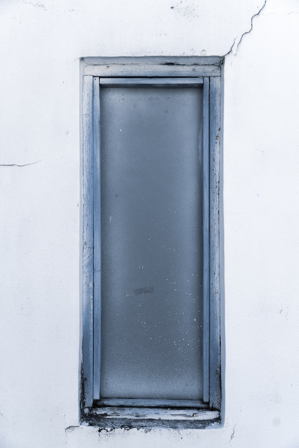 blue wooden window frame on white wall