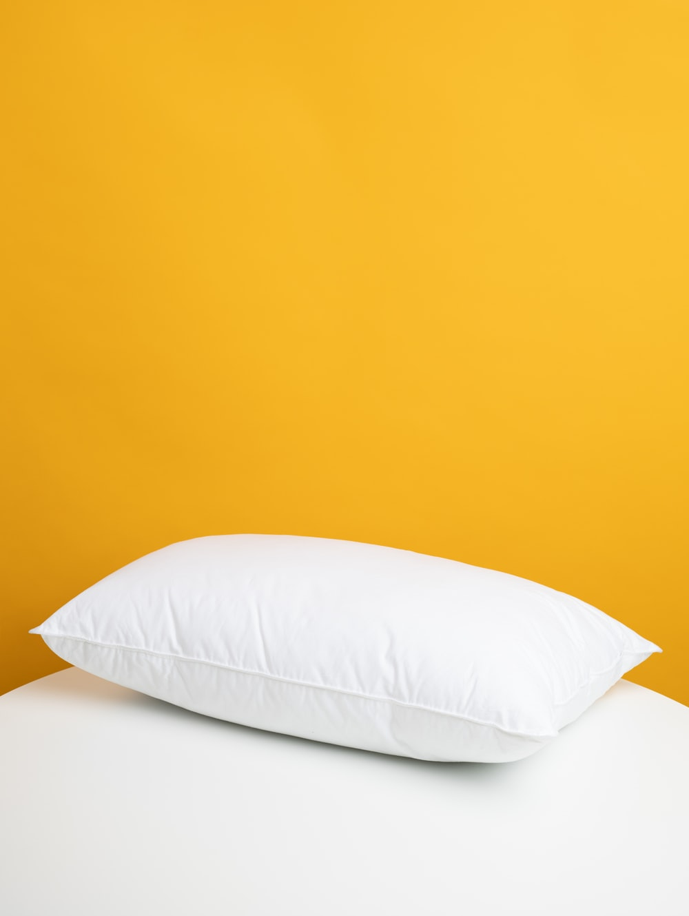 white pillow on white bed