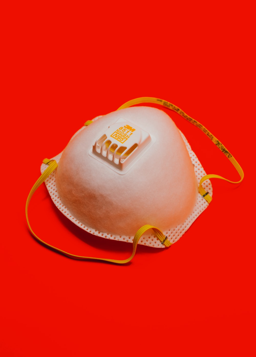 white and yellow leather sling bag