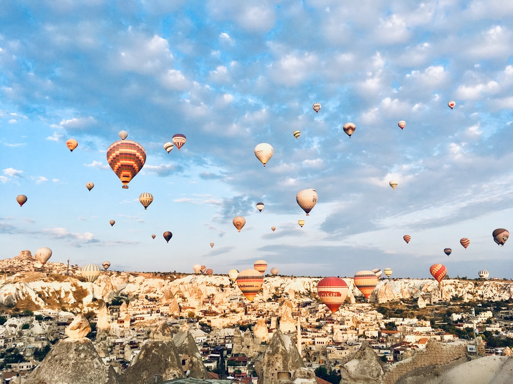 hot air balloons floating on sky during daytime