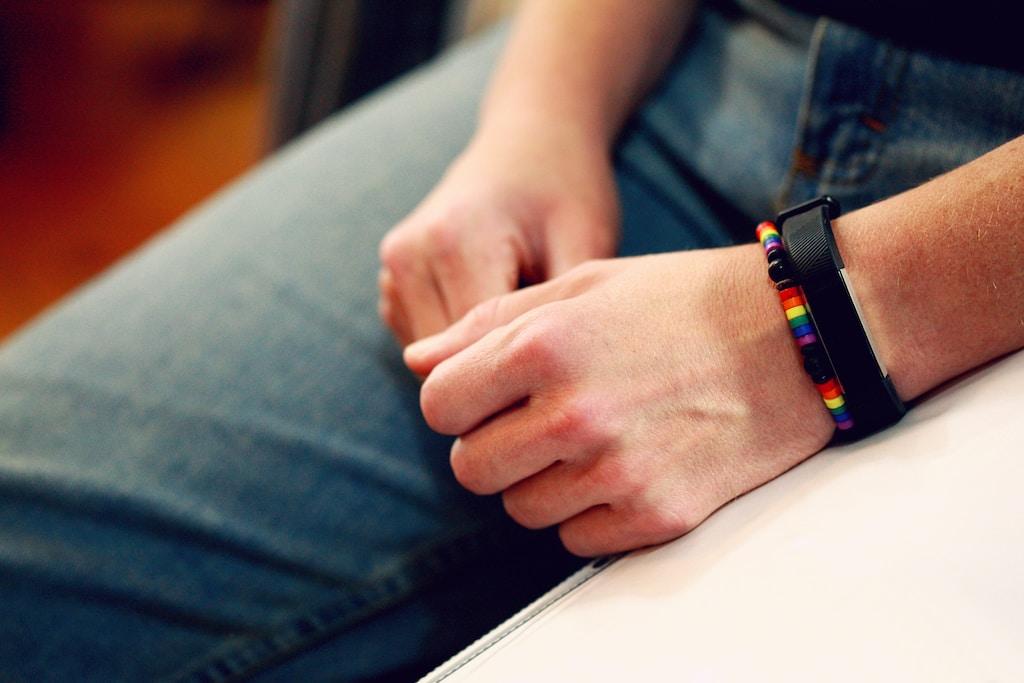 person wearing black smart watch