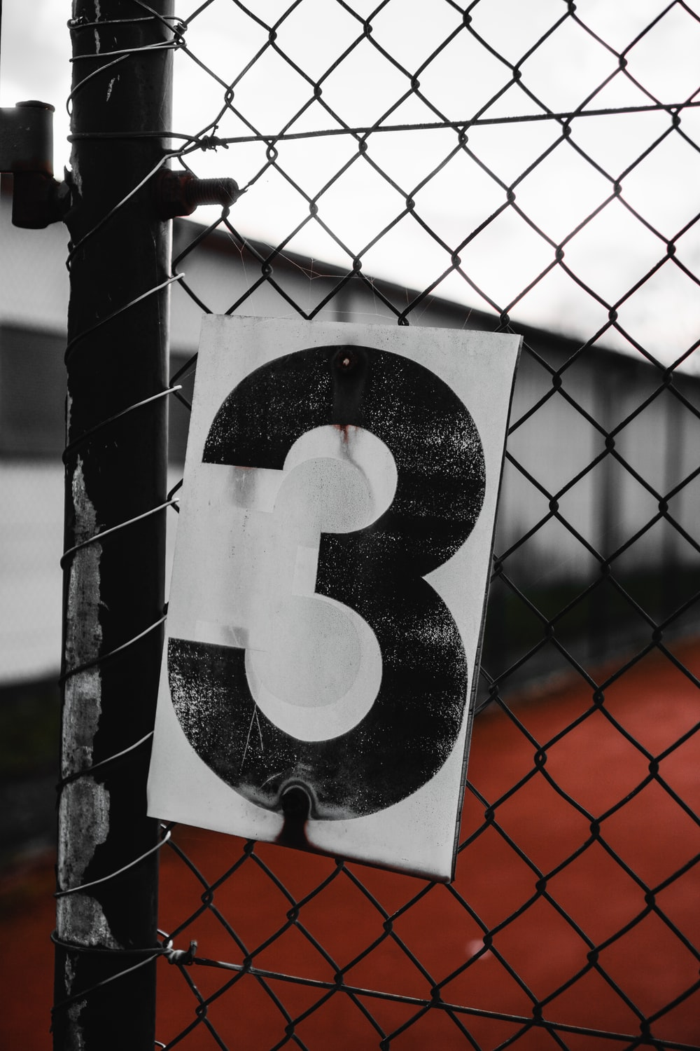 black and white number 9 on gray metal fence
