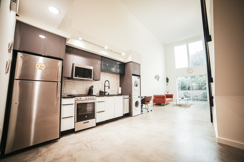 brown wooden kitchen cabinet near white wall