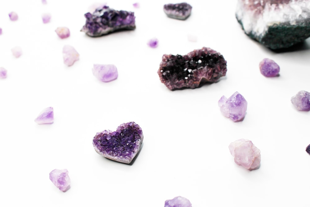 purple and white stones on white surface