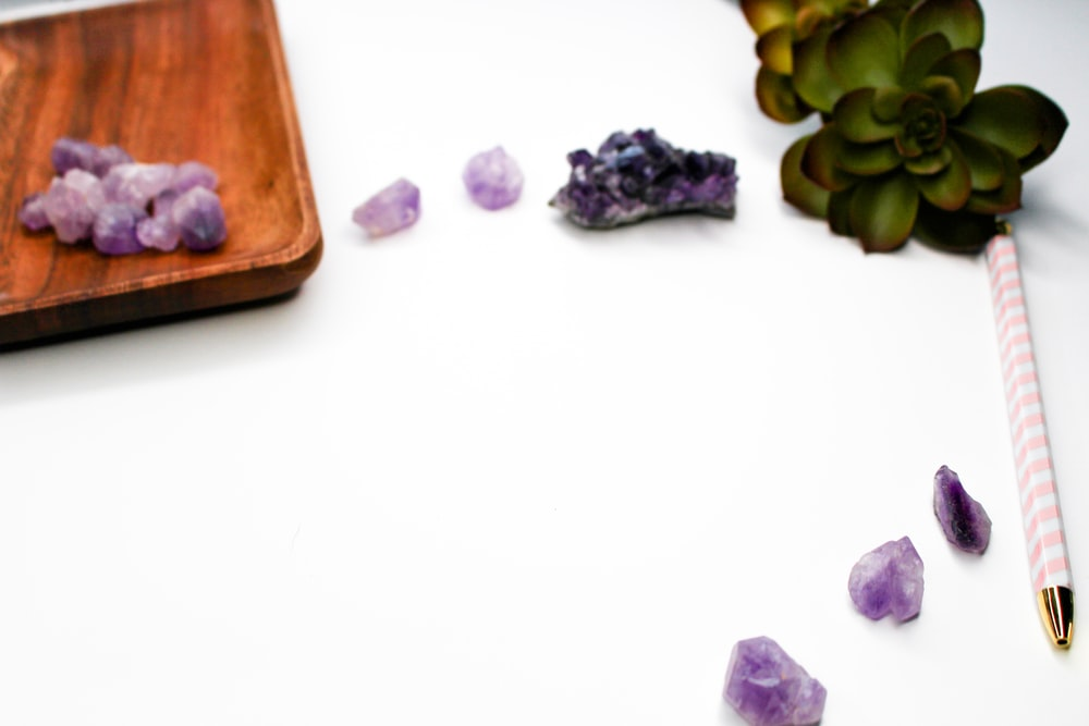 purple and green grapes on brown wooden chopping board