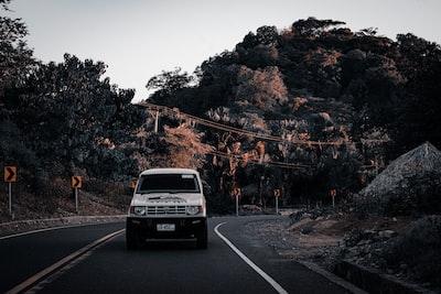 black car on road near trees during daytime timor-leste zoom background