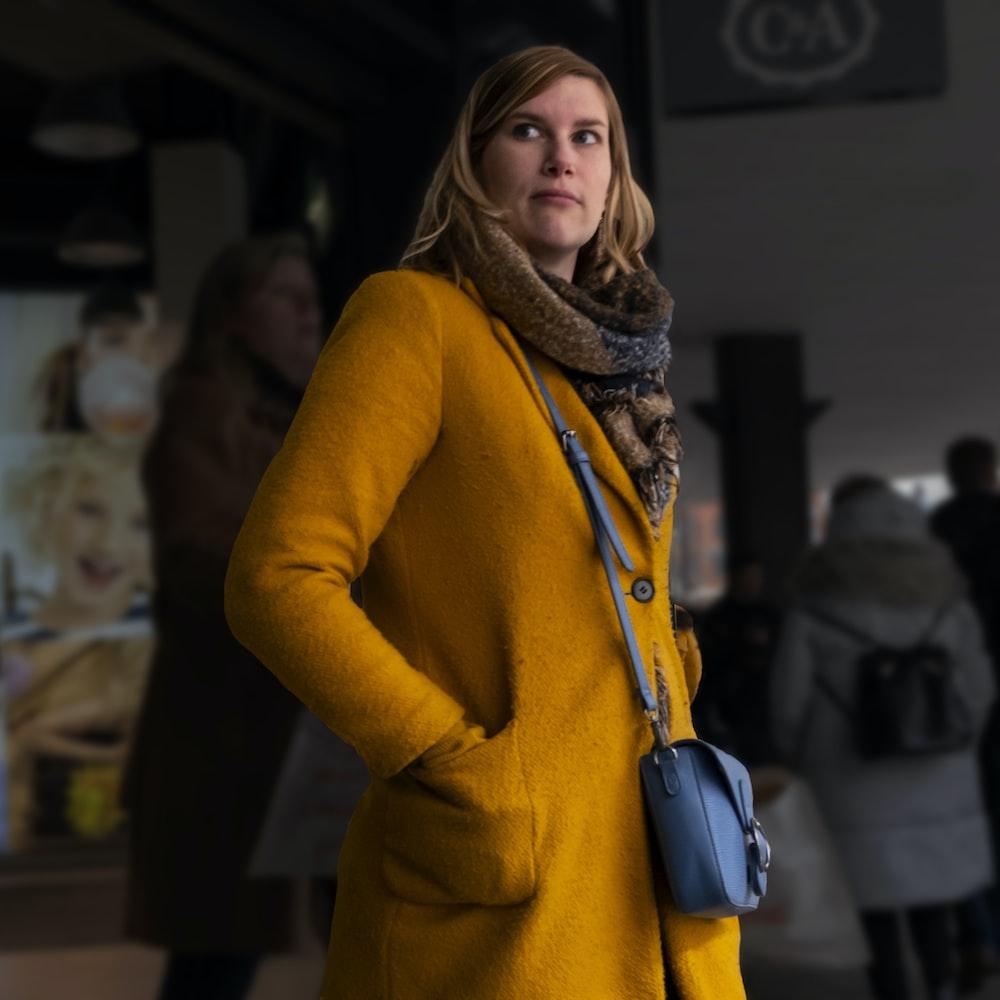 woman in brown coat standing