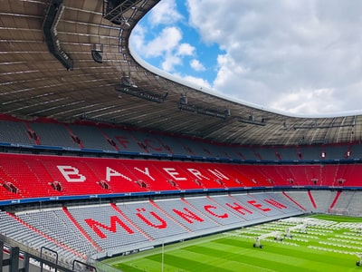 red and white stadium under blue sky during daytime