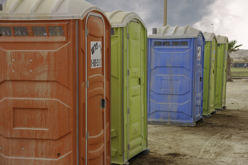 red and blue plastic trash bins
