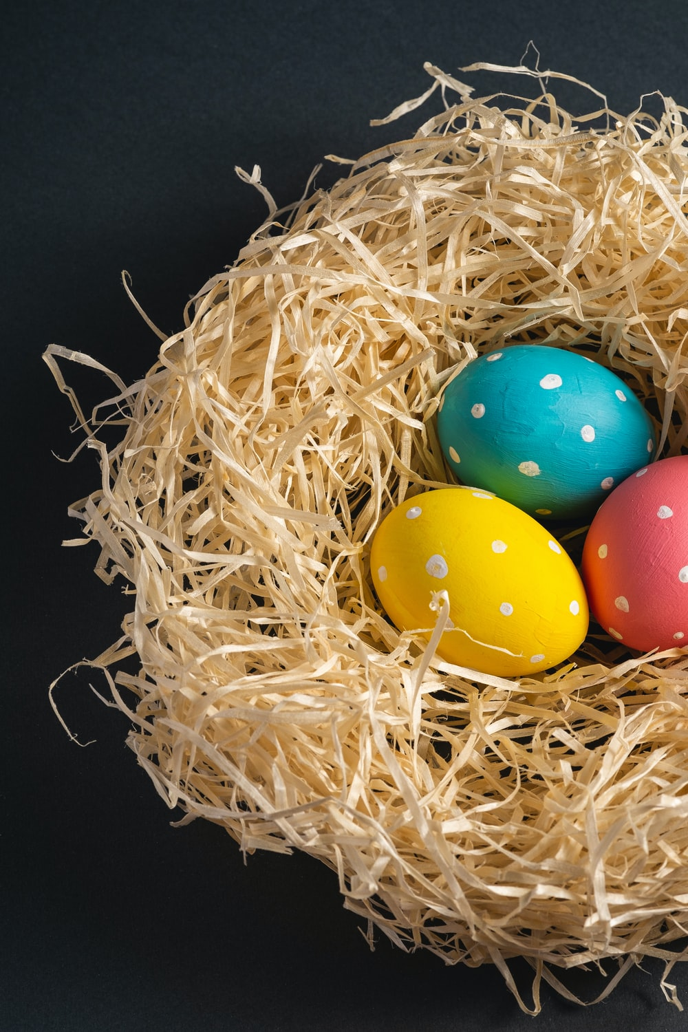 easter eggs in a brown nest