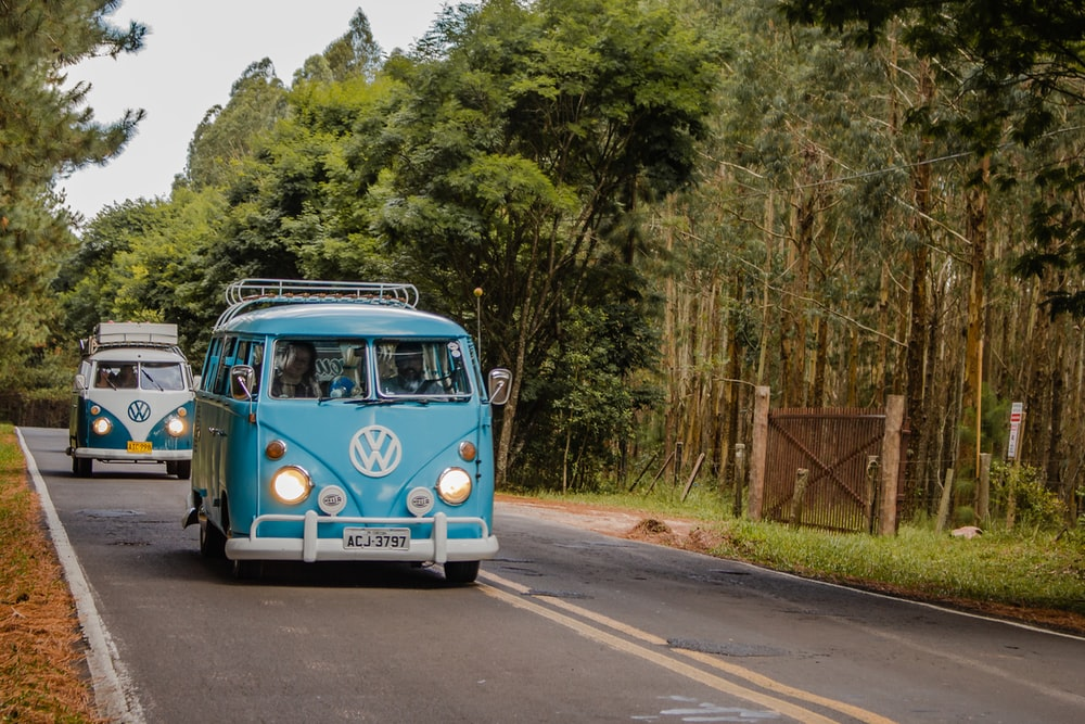 blue and white volkswagen t-2 on road during daytime