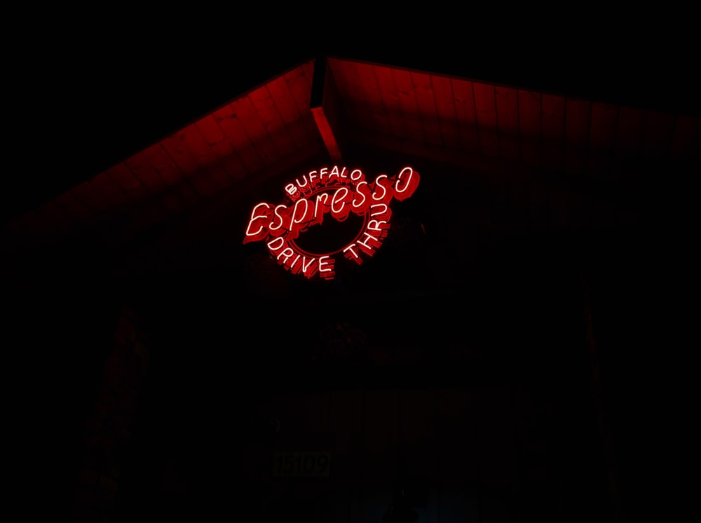 red and white coca cola neon signage