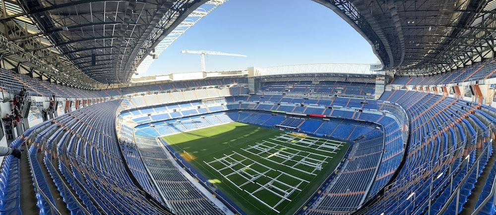 green soccer field under blue sky during daytime