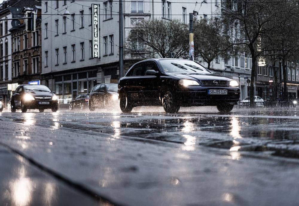 black bmw sedan on road during daytime