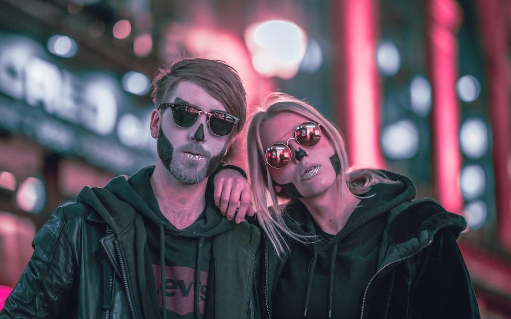 man in black leather jacket beside woman in black leather jacket