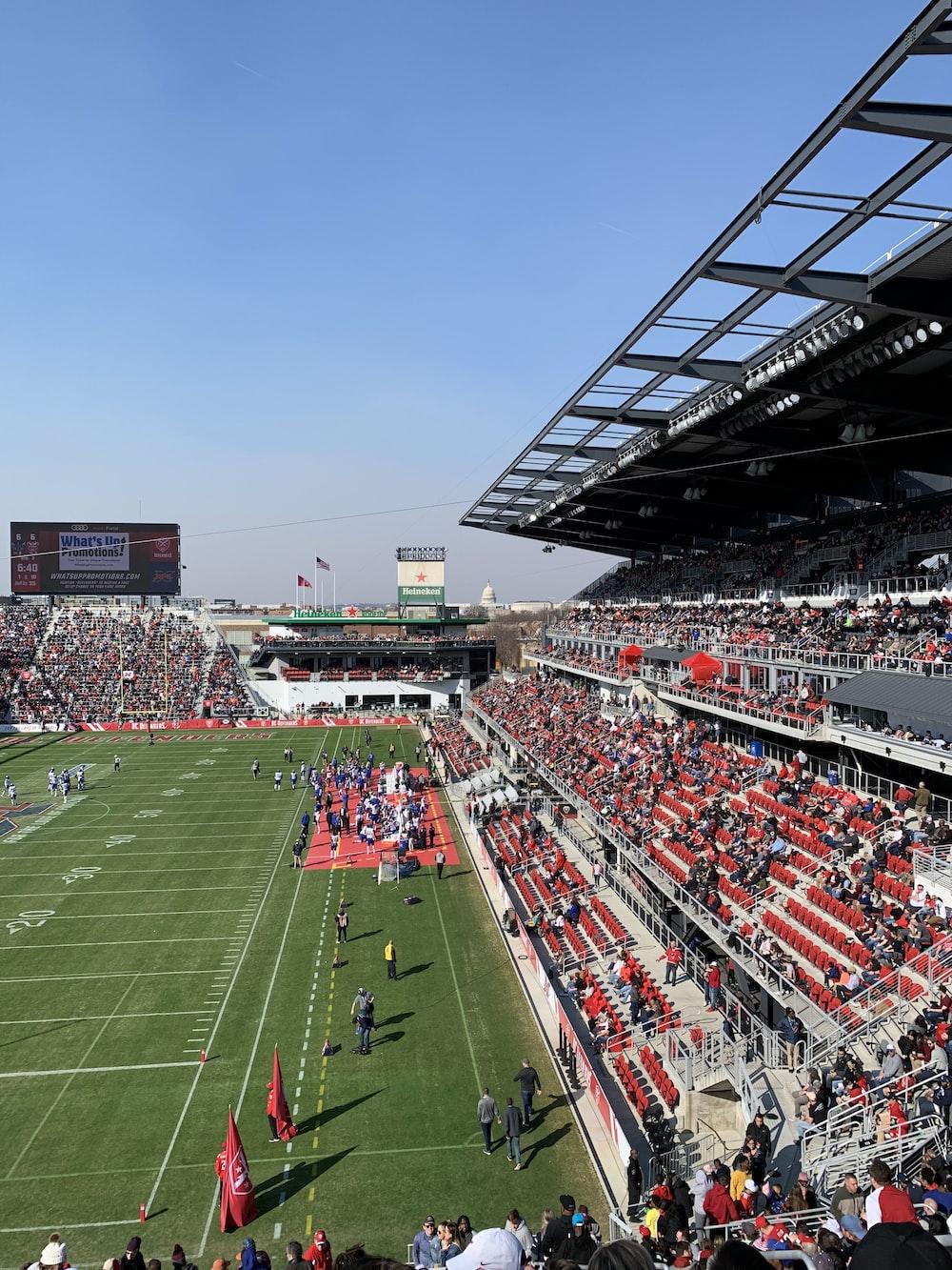 people on football stadium during daytime