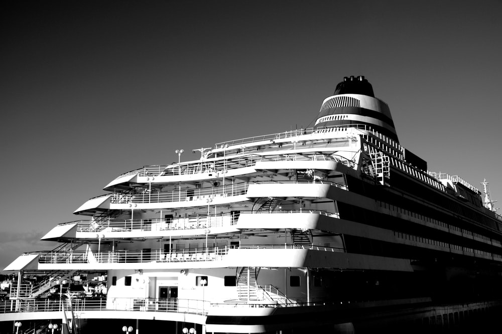 grayscale photo of white and black ship