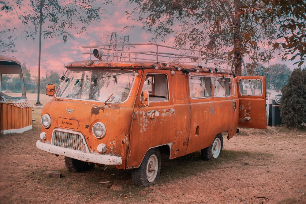 orange and white volkswagen t-2 van