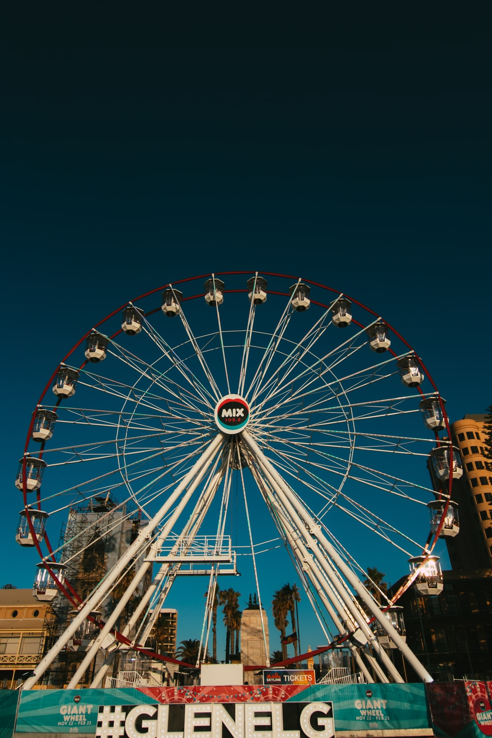 people riding on ferris wheel during night time