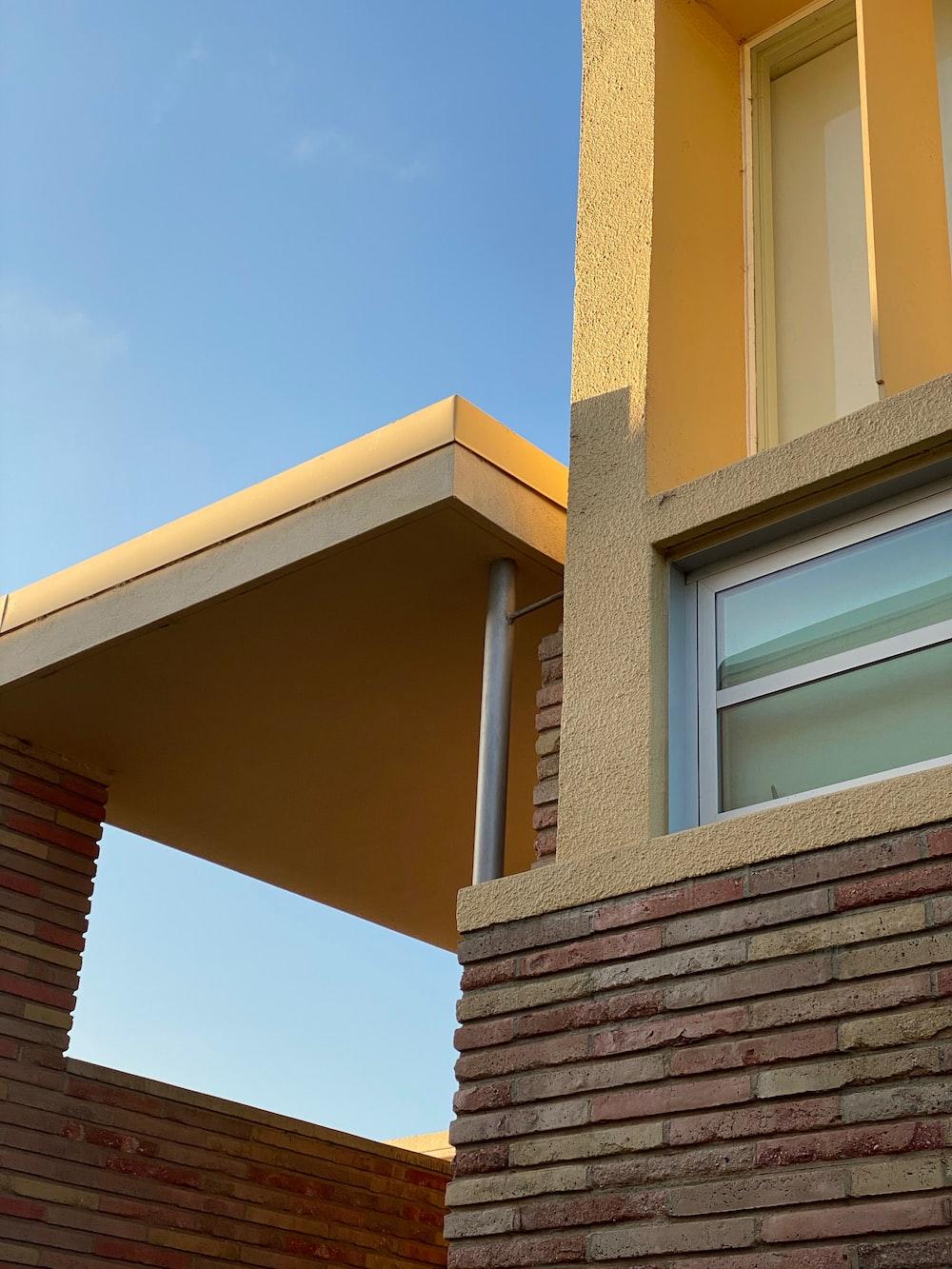 brown brick building under blue sky during daytime