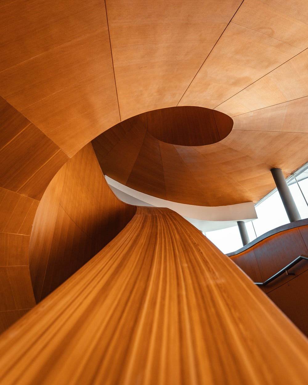 brown wooden spiral staircase with white wooden frame