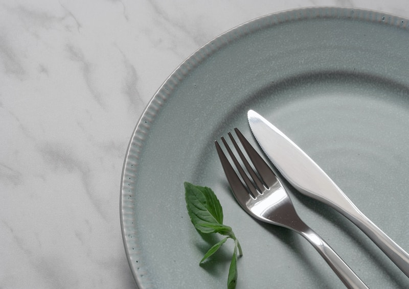 silver fork on blue round plate