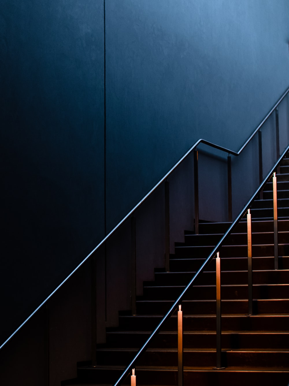 black staircase with stainless steel railings