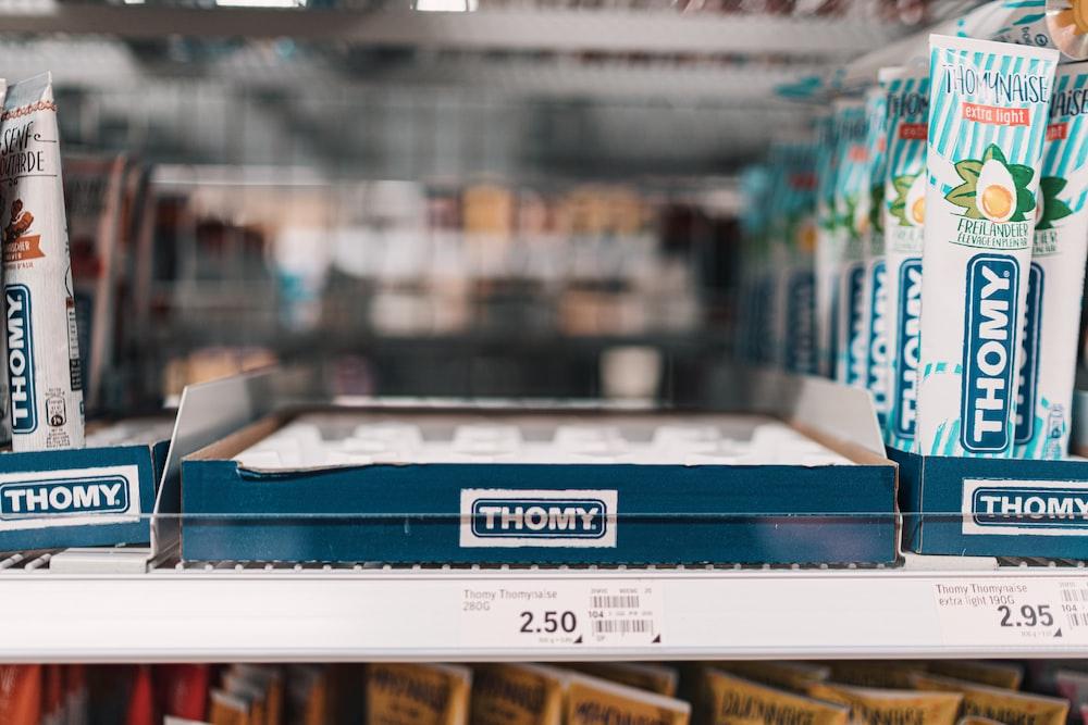 blue and white box on white shelf