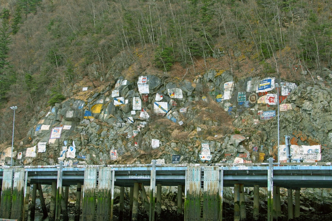The cruise ship dock at Skagway with artwork commemorating the ships that have visited here.